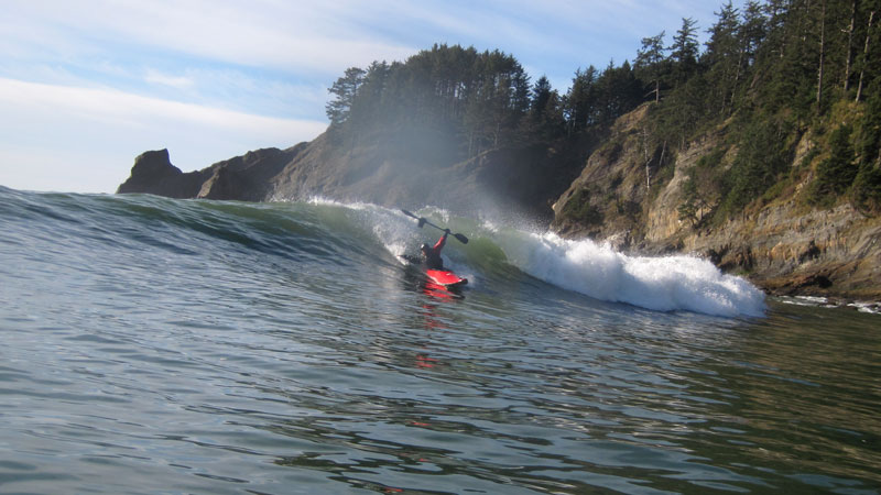 surfing a kayak on the oregon coast