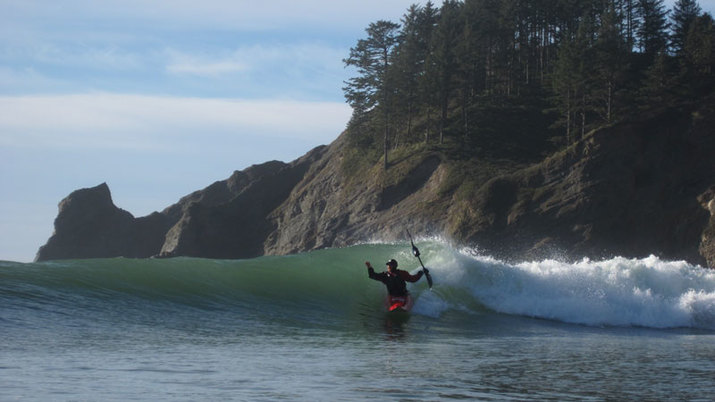 surfing a kayak at cape falcon oregon