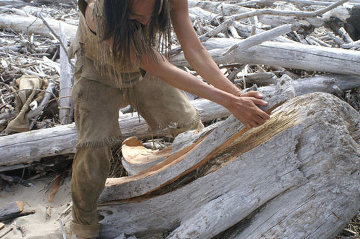 traditional kayak building with driftwood