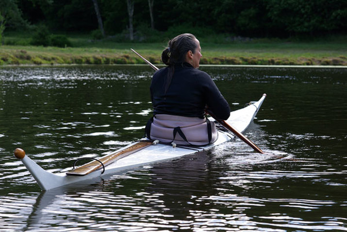paddling a skin-on-frame kayak