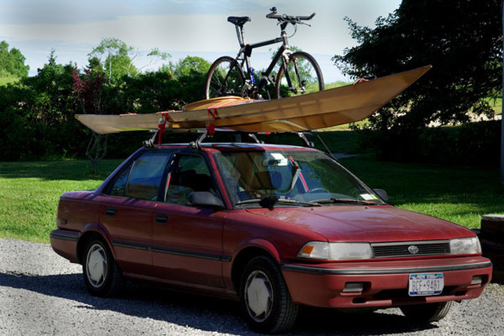 bike and kayak on top of car